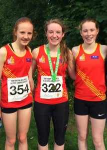L to R Hannah Gilliland and Edie Carroll flanking Aoife Cochrane who won gold in the NI and Ulster Under 17 Girls 3K Championships