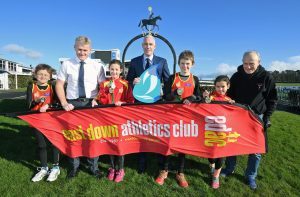 Launch of Rollercoaster Races in association with Phoenix Natural Gas - Tom McClean (Chairman EDAC) Jonathan Martindale (Phoenix Natural Gas) Joe Quinn (Race Director EDAC) and EDAC juniors at the Downpatrick Race Course venue for the event 10 March.